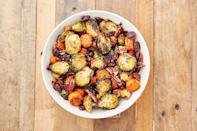 """<p>A great addition to your Sunday Roast Dinner. The dried cranberries add a tartness while the pecans add an extra crunch for a perfect side dish. We use Brussels sprouts and carrots in our medley, but feel free to add extra vegetables or swap in some of your favourites. </p><p><br>Get the <a href=""""https://www.delish.com/uk/cooking/recipes/a28934240/holiday-roasted-vegetables-recipe/"""" rel=""""nofollow noopener"""" target=""""_blank"""" data-ylk=""""slk:Best Roasted Vegetable Medley"""" class=""""link rapid-noclick-resp"""">Best Roasted Vegetable Medley </a> recipe. </p>"""