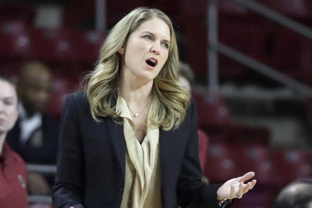 Boston College coach Joanna Bernabei-McNamee reacts from the sideline during the second half of the team's NCAA college basketball game against Louisville, Thursday, Jan. 16, 2020, in Boston. Louisville won 81-70. (AP Photo/Elise Amendola)