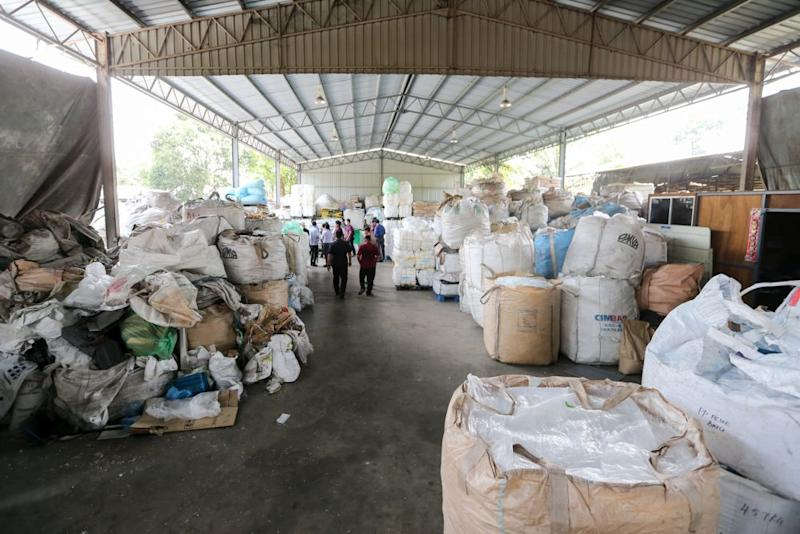 Local authorities inspect the premises of a plastic recycling plant in Kuala Langat on July 24, 2018. — Picture by Ahmad Zamzahuri