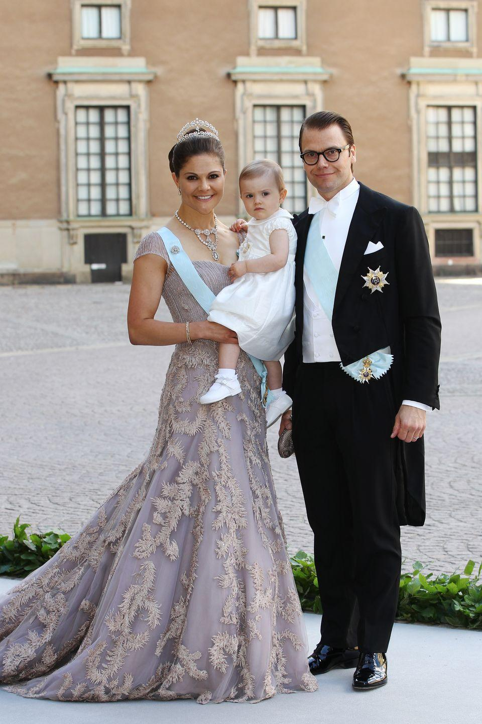 <p>The Crown Princess of Sweden is the eldest daughter of King Carl XVI Gustaf and the heir apparent to the throne. Here she is at the wedding of her sister Princess Madeleine, in Fadi El Khoury Couture, with her husband and daughter. </p>