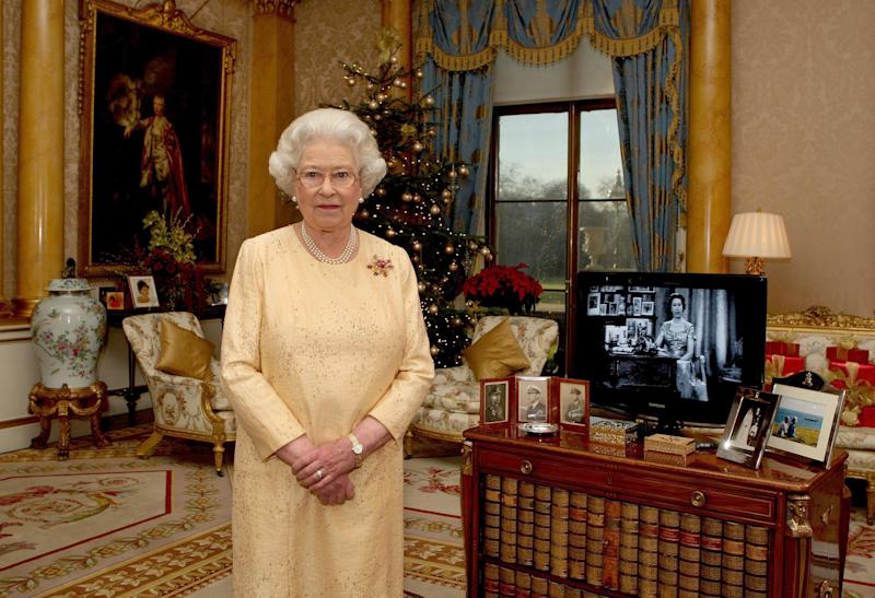 LONDON- DECEMBER 23: (NO PUBLICATION IN UK MEDIA FOR 28 DAYS) Queen Elizabeth ll delivers her Christmas speech in the 1844 Room at Buckingham Palace, marking the 50th anniversary of her first televised Noel message, on December 23, 2007 in London, England. (Photo by Pool/Anwar Hussein Collection/WireImage)