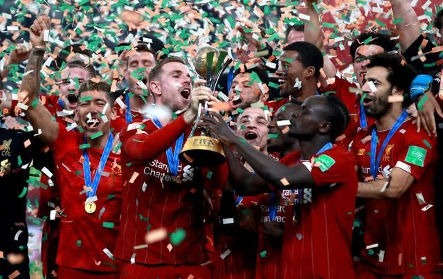 Liverpool took time out from their relentless title march to win the FIFA Club World Cup in Qatar. Reds captain Jordan Henderson lifted the trophy at the Khalifa International Stadium in Doha after Roberto Firmino scored an extra-time winner against Brazilian club Flamengo (Adam Davy/PA)