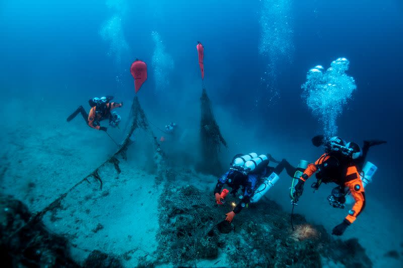 Divers haul ghost nets from submarine wreck in Greece's Ionian Sea