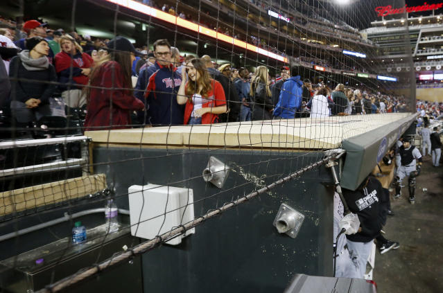 "Each MLB club has agreed extend protective netting to ""at least the far ends of both dugouts"" ahead of the 2018 season. (AP Photo/Jim Mone, File)"