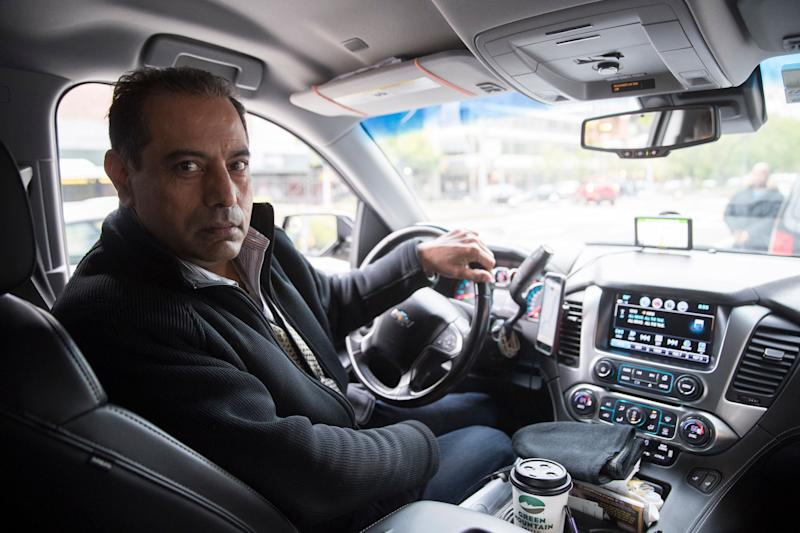 "This Friday, May 3, 2019 photo shows Uber driver and NYTWA member Inder Parmar in his vehicle in New York. ""The drivers are the one who helped Uber to be $100 billion, nobody else, and the drivers are the ones who are suffering,"" said Parmar, 54, who lives in a suburb of New York City. ""Uber and Lyft, they figured out how to exploit the drivers, and that's what they're doing right now."" (AP Photo/Mary Altaffer)"