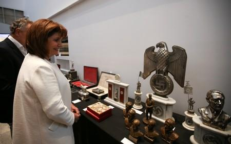 Argentine Security Minister Bullrich looks at Nazi artefacts before a news conference at the Holocaust museum in Buenos Aires
