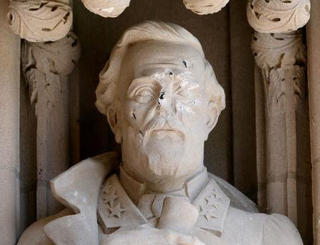 Damage done to the face of a statue of Confederate commander General Robert E. Lee is seen, at Duke University's Duke Chapel in Durham, North Carolina, U.S. August 17, 2017. REUTERS/Jonathan Drake