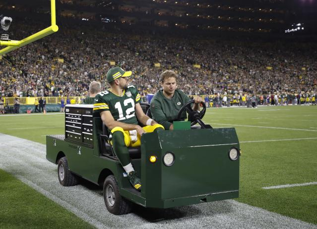 Packers quarterback Aaron Rodgers isn't practicing on Thursday, after suffering a knee injury last week. (AP)