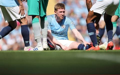 Kevin De Bruyne of Manchester City sits down after suffering an injury in the first half during the Premier League match between Manchester City and Tottenham Hotspur - Credit: GETTY IMAGES