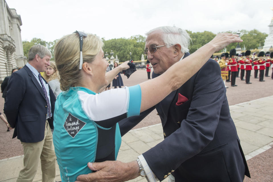 LONDON UNITED KINGDOM - SEPTEMBER 25:  Sophie, Countess of Wessex is welcomed by her Father Christopher Rhys-Jones as she arrives at Buckingham Palace having completed a cycle ride from Edinburgh on behalf of the Duke of Edinburgh's Award on September 25, 2016 in London, United Kingdom.  The Countess and the other riders were presented with a Diamond Pin to mark the completion of the Diamond Challenge. The Countess of Wessex cycled 445 miles from the Palace of Holyroodhouse, Edinburgh to Buckingham Palace, London over seven days as her 'Diamond Challenge' - a special initiative marking the 60th anniversary of the Duke of Edinburgh's Award. (Photo by  Paul Grover - WPA Pool/Getty Images)