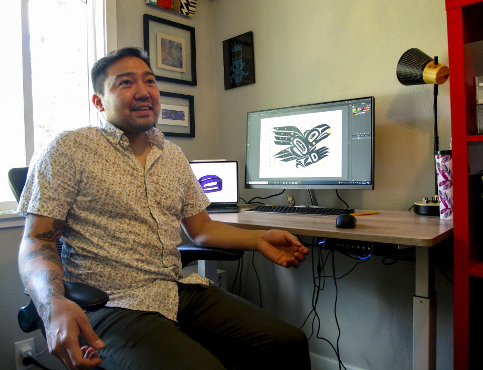 Alaska Native artist Rico Worl displays an image of the U.S. Postal Service stamp he created on his monitor, at his studio in Juneau, Alaska, Thursday, July 29, 2021. A ceremony marking the release of Worl's Raven Story stamp is set in Juneau for Friday, July 30. (AP Photo/Becky Bohrer)