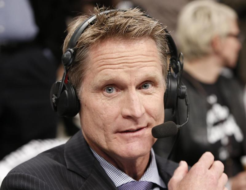 TNT commentator and former Chicago Bulls and San Antonio Spurs guard Steve Kerr broadcasts courtside for Game 4 of an NBA basketball first-round playoff series between the Toronto Raptors and the Brooklyn Nets, Sunday, April 27, 2014, in New York. Kerr said Sunday he spoke with New York Knicks President Phil Jackson twice over the weekend and that they will continue discussing his potential of becoming coach of the team