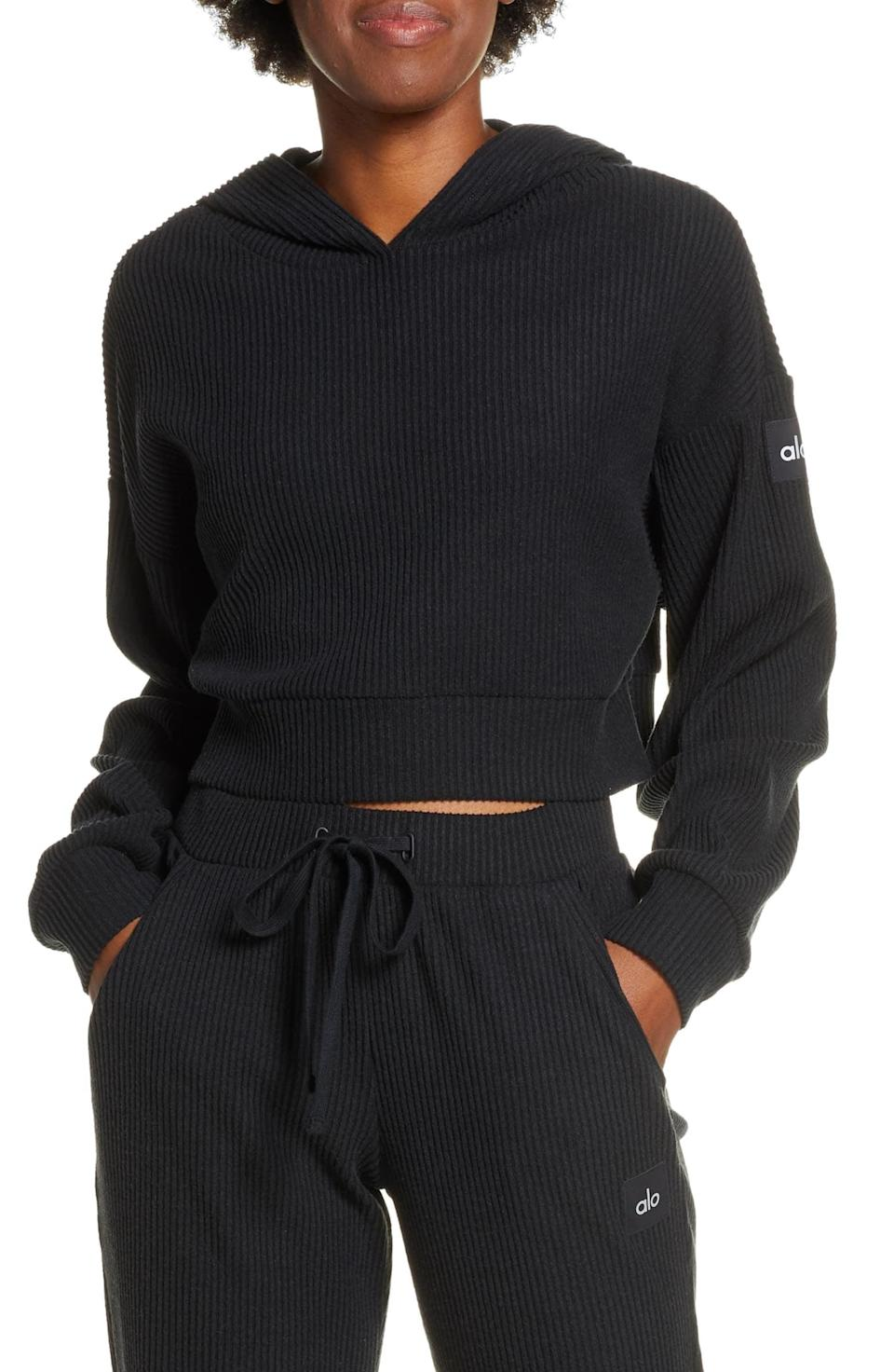 <p>This classic black <span>Alo Muse Ribbed Crop Hoodie</span> ($88) goes with everything. </p>