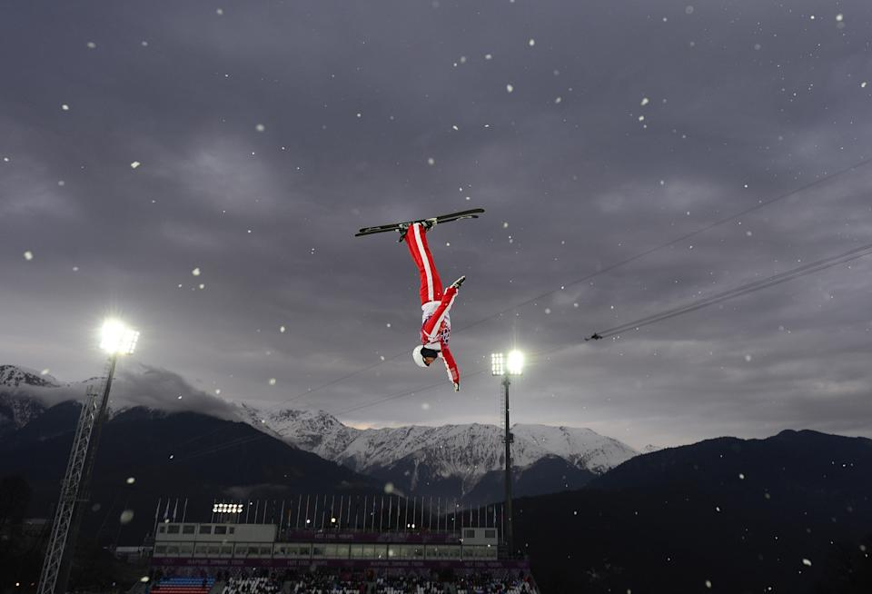 Mischa Gasser flies high over PyeongChang while below his father watches. (Getty)