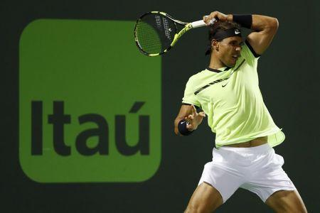 Mar 29, 2017; Miami, FL, USA; Rafael Nadal of Spain hits a forehand against Jack Sock of the United States (not pictured) on day nine of the 2017 Miami Open at Crandon Park Tennis Center. Nadal won 6-2, 6-3. Mandatory Credit: Geoff Burke-USA TODAY Sports