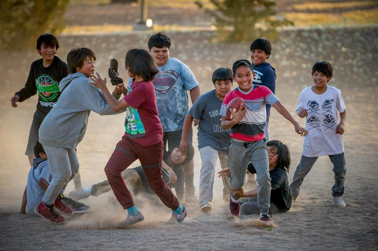 Children play football in Tuba City on the Navajo Nation. (Photograph by Mary F. Calvert)