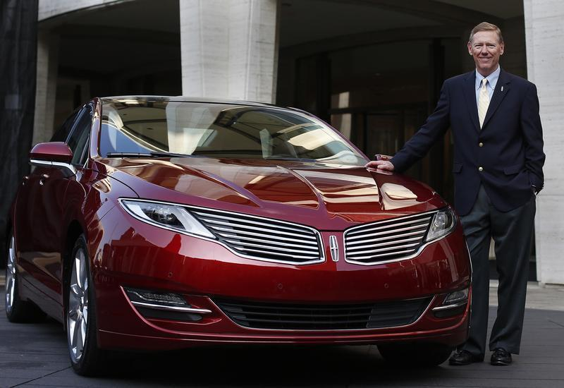 Mulally, president and CEO of Ford Motor Company, stands next to Lincoln MKZ mid-size sedan during news conference in New York