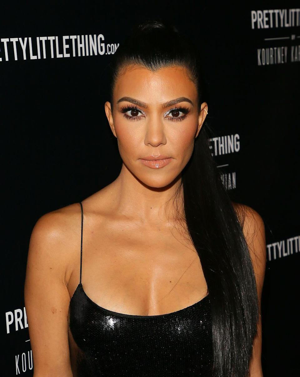 """<p>In the past, Kourtney shared on <em>KUWTK </em>that she got breast implants when she was 22 years old. """"I had my boobs done, but if I could go back, I wouldn't have done it,"""" she <a href=""""https://people.com/health/crystal-hefner-kourtney-kardashian-celebs-who-regret-getting-breast-implants/#kourtney-kardashian"""" rel=""""nofollow noopener"""" target=""""_blank"""" data-ylk=""""slk:told"""" class=""""link rapid-noclick-resp"""">told </a><em><a href=""""https://people.com/health/crystal-hefner-kourtney-kardashian-celebs-who-regret-getting-breast-implants/#kourtney-kardashian"""" rel=""""nofollow noopener"""" target=""""_blank"""" data-ylk=""""slk:Showbiz Spy"""" class=""""link rapid-noclick-resp"""">Showbiz Spy</a></em> in 2011. """"I was so cute before."""" She also added that she had considered removing them! </p>"""