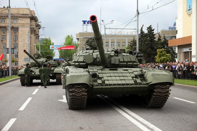 A pro-Russian separatist tank rolls down the street during a military parade being held by the self-proclaimed Donetsk People's Republic on May 9, 2015 in Donetsk, Ukraine to mark 70 years since victory over Nazi Germany in WWII (AFP Photo/Aleksey Filippov)
