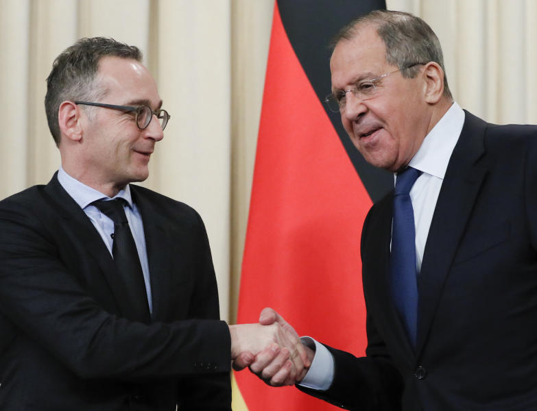 Russian Foreign Minister Sergey Lavrov, right, and Germany's Foreign Minister Heiko Maas shake hands after their talks in Moscow, Russia, Friday, Jan. 18, 2019. Germany's foreign minister has urged Russia to save a key arms treaty with the U.S. to prevent a new arms race. (AP Photo)