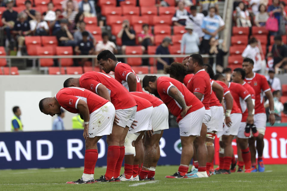 Tonga players bow to the crowd following their 28-12 loss to Argentina during the Rugby World Cup Pool C game at Hanazono Rugby Stadium in Osaka, Japan, Saturday, Sept. 28, 2019. (AP Photo/Aaron Favila)