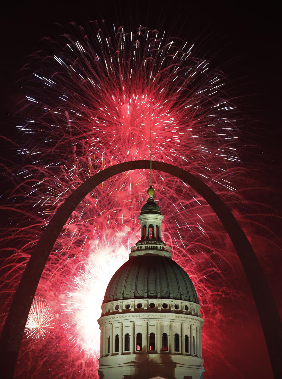 Fireworks light up the night sky over the Gateway Arch and Old Courthouse as part of an Independence Day celebration, July 4, 2019, in St. Louis. (Photo: Jeff Roberson/AP)