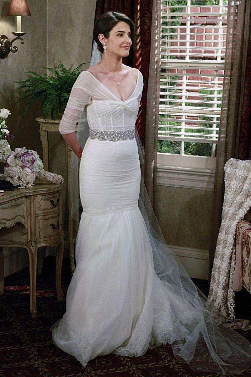 """<p>Robin wore a sheer <a href=""""http://www.phillymag.com/philadelphia-wedding/2014/03/26/heres-robins-wedding-dress-met-mother-find-philly/"""" rel=""""nofollow noopener"""" target=""""_blank"""" data-ylk=""""slk:Monique Lhuillier"""" class=""""link rapid-noclick-resp"""">Monique Lhuillier</a> dress with three-quarter length sleeves, a mermaid skirt, and a crystal belt for added sparkle. She wore the gown for her season 9 wedding to Barney. </p>"""