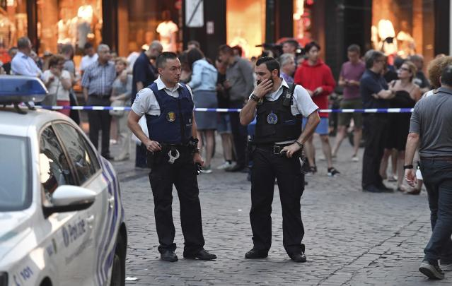 <p>Belgian police stand in front of a police cordon as people are evacuated at the Grand Place square near Central Station in Brussels after a reported explosion on Tuesday, June 20, 2017. Belgian media are reporting that explosion-like noises have been heard at a Brussels train station, prompting the evacuation of a main square. (AP Photo/Geert Vanden Wijngaert) </p>