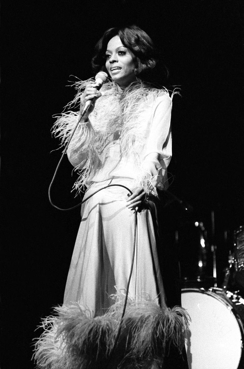 <p>Diana Ross is the epitome of '70s glam. If you're looking for a fun yet chic costume to impress your coworkers, you can't go wrong with a feathered robe or shawl slipped over a slinky slipdress, emulating the superstar in her prime.</p>
