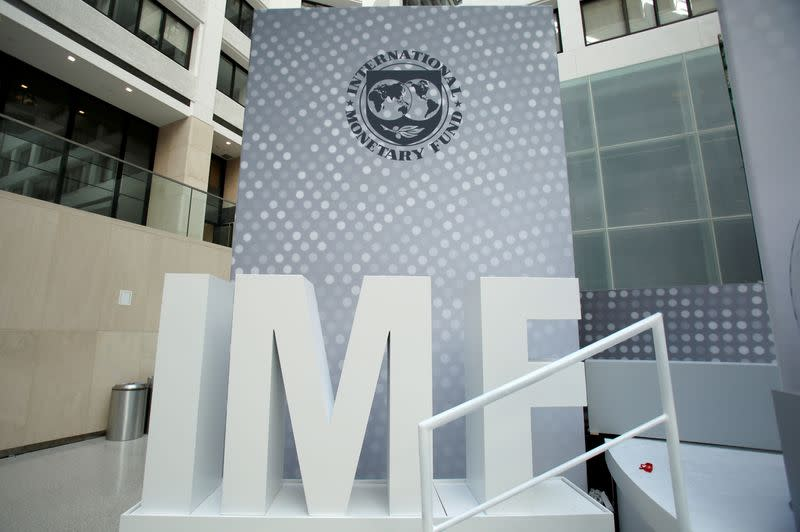 FILE PHOTO: International Monetary Fund logo is seen inside the headquarters at the end of the IMF/World Bank annual meetings