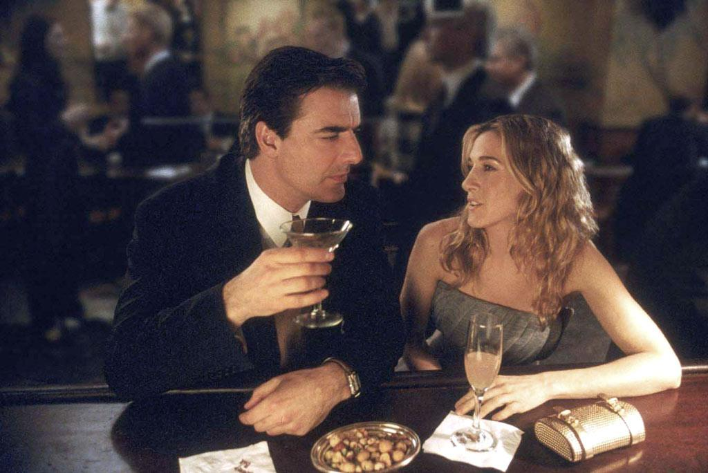 "Throughout their tumultuous relationship, Mr. Big (Chris Noth) took Carrie to a lot of swanky Manhattan bars. This gave the fashion fanatic a perfect excuse to buy a new dress for each and every occasion. The Kobal Collection/<a href=""http://www.wireimage.com"" target=""new"">WireImage.com</a>"