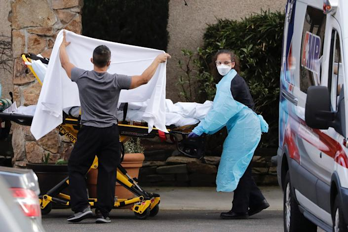 A person on a stretcher at a Washington State nursing facility where more than 50 people are being tested for COVID-19 on February 29, 2020.