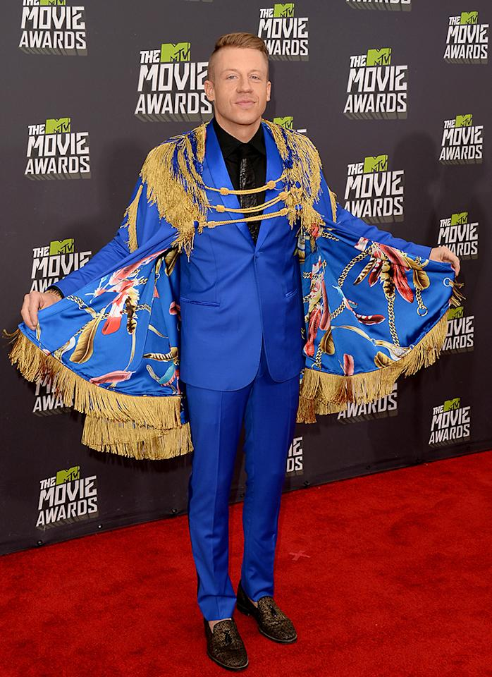 Macklemore arrives at the 2013 MTV Movie Awards at Sony Pictures Studios on April 14, 2013 in Culver City, California.