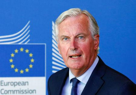 FILE PHOTO: European Union's chief Brexit negotiator, Michel Barnier attends a media briefing with Britain's Secretary of State for Exiting the European Union, Dominic Raab, after a meeting at the EU Commission headquarters in Brussels
