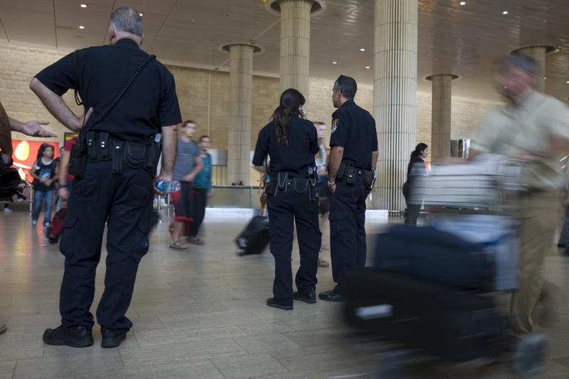 FILE - In this Thursday, July 7, 2011 file photo, Israeli police officers stand guard at Ben Gurion international airport near Tel Aviv , Israel. In a modern twist on Israel's vaunted history of airport security, the country has begun forcing incoming travelers deemed suspicious to open their personal e-mail accounts for inspection. (AP Photo/Ariel Schalit, File)