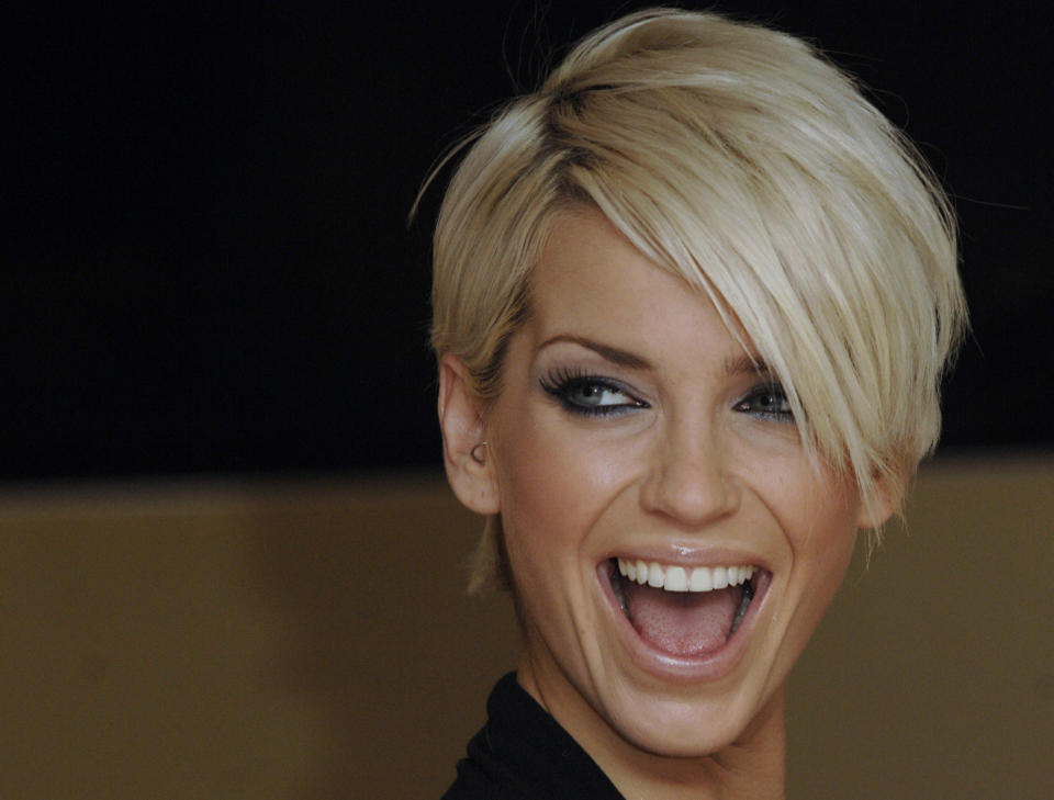 British singer Sarah Harding from girl band Girls Aloud poses at the launch of the new 'Ultimo lingerie' department in Debenhams Oxford street store, London November 12, 2007. REUTERS/Anthony Harvey  (BRITAIN)