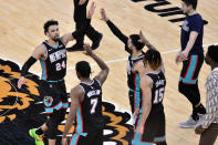 Memphis Grizzlies guard Dillon Brooks (24) greets teammates after scoring during the second half of the team's NBA basketball game against the Los Angeles Clippers on Thursday, Feb. 25, 2021, in Memphis, Tenn. (AP Photo/Brandon Dill)