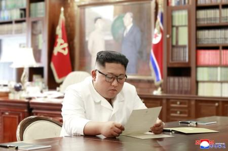 North Korean leader Kim Jong Un reads a letter from U.S. President Donald Trump, in Pyongyang