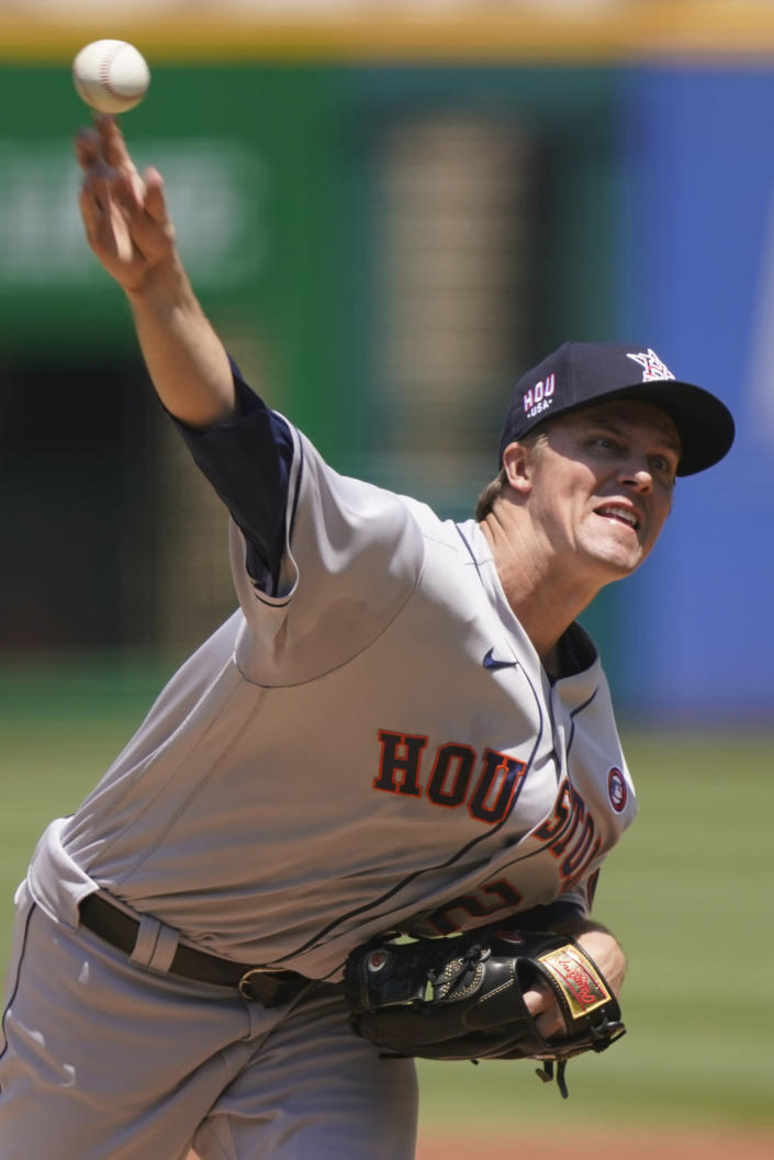 Houston Astros starting pitcher Zack Greinke delivers in the first inning of a baseball game against the Cleveland Indians, Sunday, July 4, 2021, in Cleveland. (AP Photo/Tony Dejak)