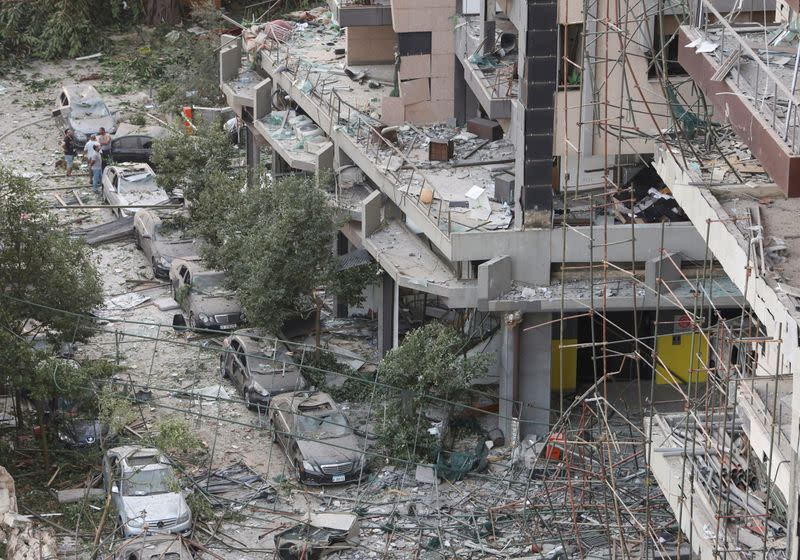 FILE PHOTO: People inspect the damage near the site of Tuesday's blast in Beirut's port area