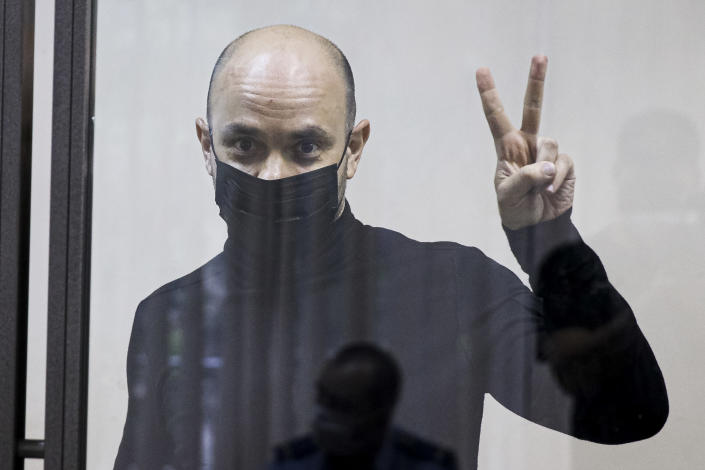 """Andrei Pivovarov, the head of Open Russia movement gestures during a court session in Krasnodar, Russia, Wednesday, June 2, 2021. Two opposition activists in Russia prepared for court hearings Wednesday as authorities continue to crack down on dissent ahead of the country's September parliamentary election. Pivovarov was pulled off a Warsaw-bound plane at St. Petersburg's airport just before takeoff late Monday and taken to Krasnodar, where authorities accused him of supporting a local election candidate last year on behalf of an """"undesirable"""" organization. (AP Photo)"""