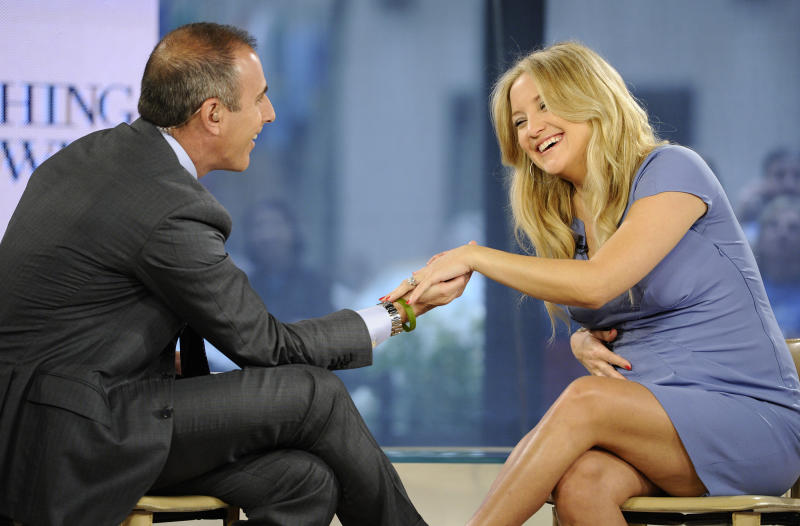 """In this photo released by NBC Universal, Inc., """"Today"""" show co-host Matt Lauer talks with actress Kate Hudson on the """"Today"""" show about her new movie """"Something Borrowed,"""" her pregnancy and recent engagement to Matthew Bellamy, Wednesday, April 27, 2011, in New York. (AP Photo/NBC Universal, Inc., Peter Kramer)"""