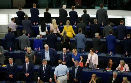 Members of the Brexit Party turn their back to the assembly as the European anthem is played during the first plenary session of the newly elected European Parliament in Strasbourg