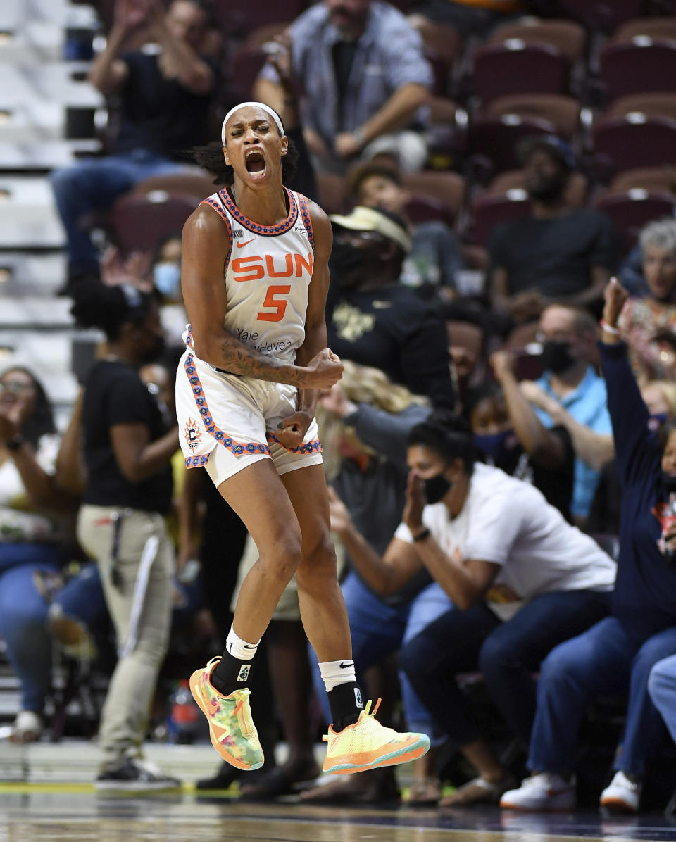 Connecticut Sun guard Jasmine Thomas celebrates a 3-pointer by Briann January against the Los Angeles Sparks during a WNBA basketball game Saturday, Aug. 28, 2021, in Uncasville, Conn. (Sean D. Elliot/The Day via AP)