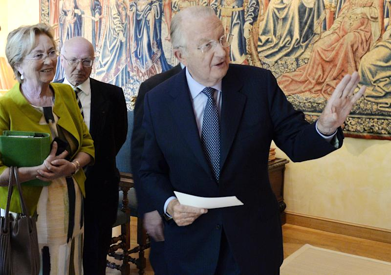 Belgian King Albert II, right, gestures, moments before he addresses the nation in a television speech at the Royal Palace in Brussels, Wednesday, July 3, 2013. Belgian King Albert has unexpectedly announced that he will step down in favor of his son, Crown Prince Philippe. on July 21, 2013. At left is Queen Paola, next to Chief of Cabinet, Jacques van Ypersele de Strihou. (AP Photo/Eric Lalmand, pool)