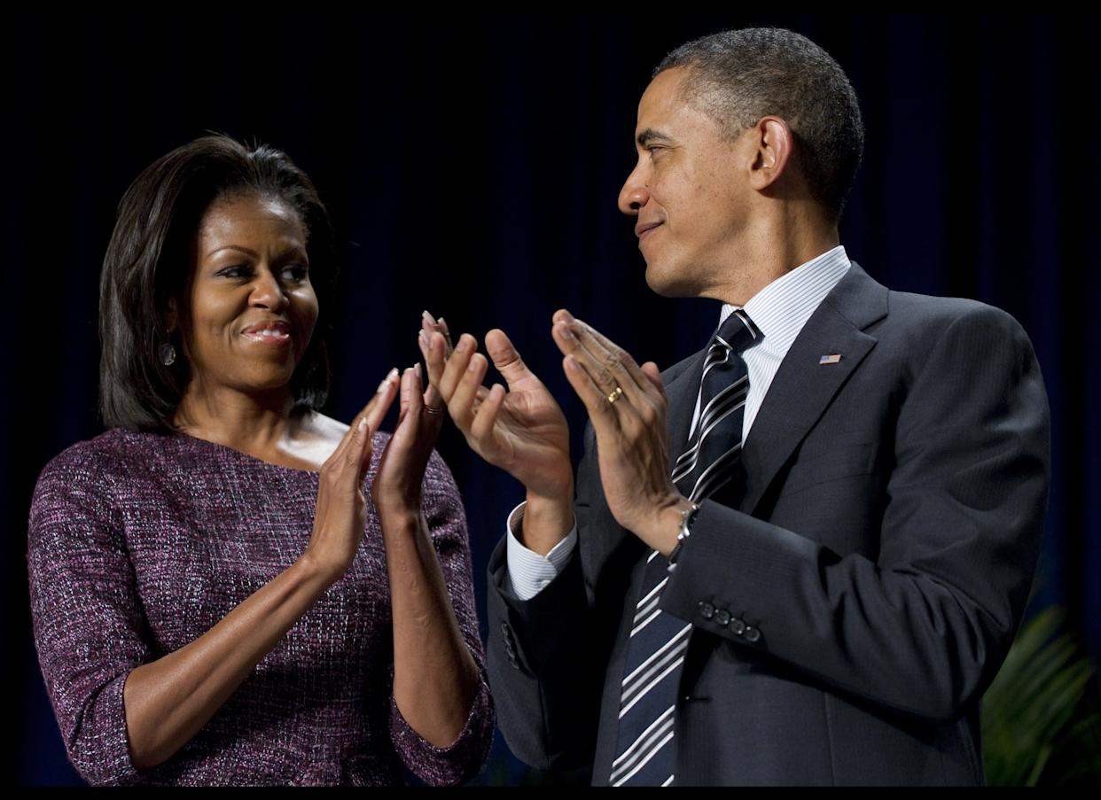 US President Barack Obama applauds alongside First Lady Michelle Obama during the National Prayer Breakfast at the Washington Hilton in Washington, DC, February 2, 2012. AFP PHOTO / Saul LOEB (Photo credit should read SAUL LOEB/AFP/Getty Images)