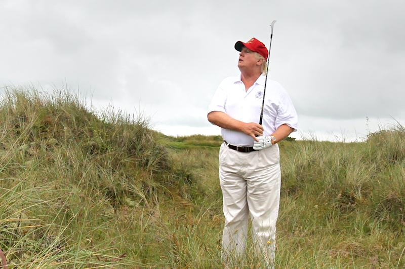 Donald Trump plays from the rough on the second hole after officially opening the Trump International Golf Links golf course near Aberdeen. (Photo by Andrew Milligan/PA Images via Getty Images)