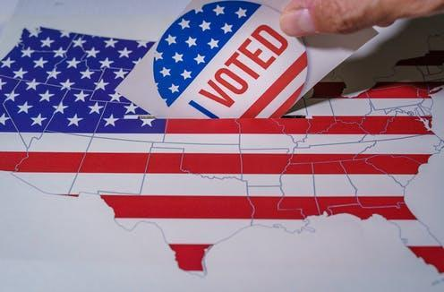 """<span class=""""caption"""">Around 3 million Americans who live abroad are eligible to vote. </span> <span class=""""attribution""""><a class=""""link rapid-noclick-resp"""" href=""""https://www.shutterstock.com/image-photo/usa-elections-2020-hand-man-putting-1796202586"""" rel=""""nofollow noopener"""" target=""""_blank"""" data-ylk=""""slk:Ivan Marc/Shutterstock"""">Ivan Marc/Shutterstock</a></span>"""
