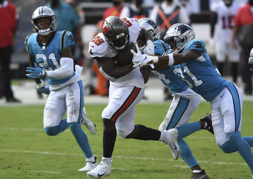 Tampa Bay Buccaneers running back Leonard Fournette (28) is stopped by Carolina Panthers strong safety Juston Burris (31) during the second half of an NFL football game Sunday, Sept. 20, 2020, in Tampa, Fla. (AP Photo/Jason Behnken)