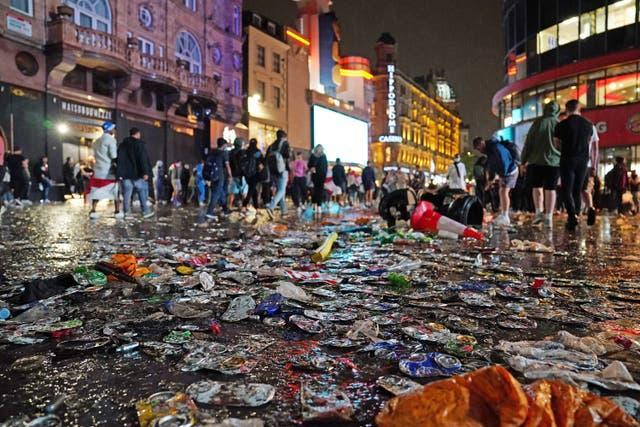 Debris covers a street in London's Leicester Square after Italy won the Uefa Euro 2020 Final against England (Aaron Chown/PA)